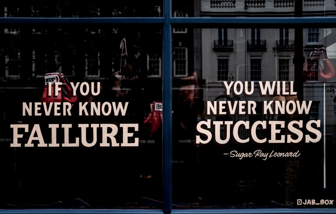 """The windows of a boxing gym with the quote """"If you never know failure you will never know success"""" - Sugar Ray Leonard"""